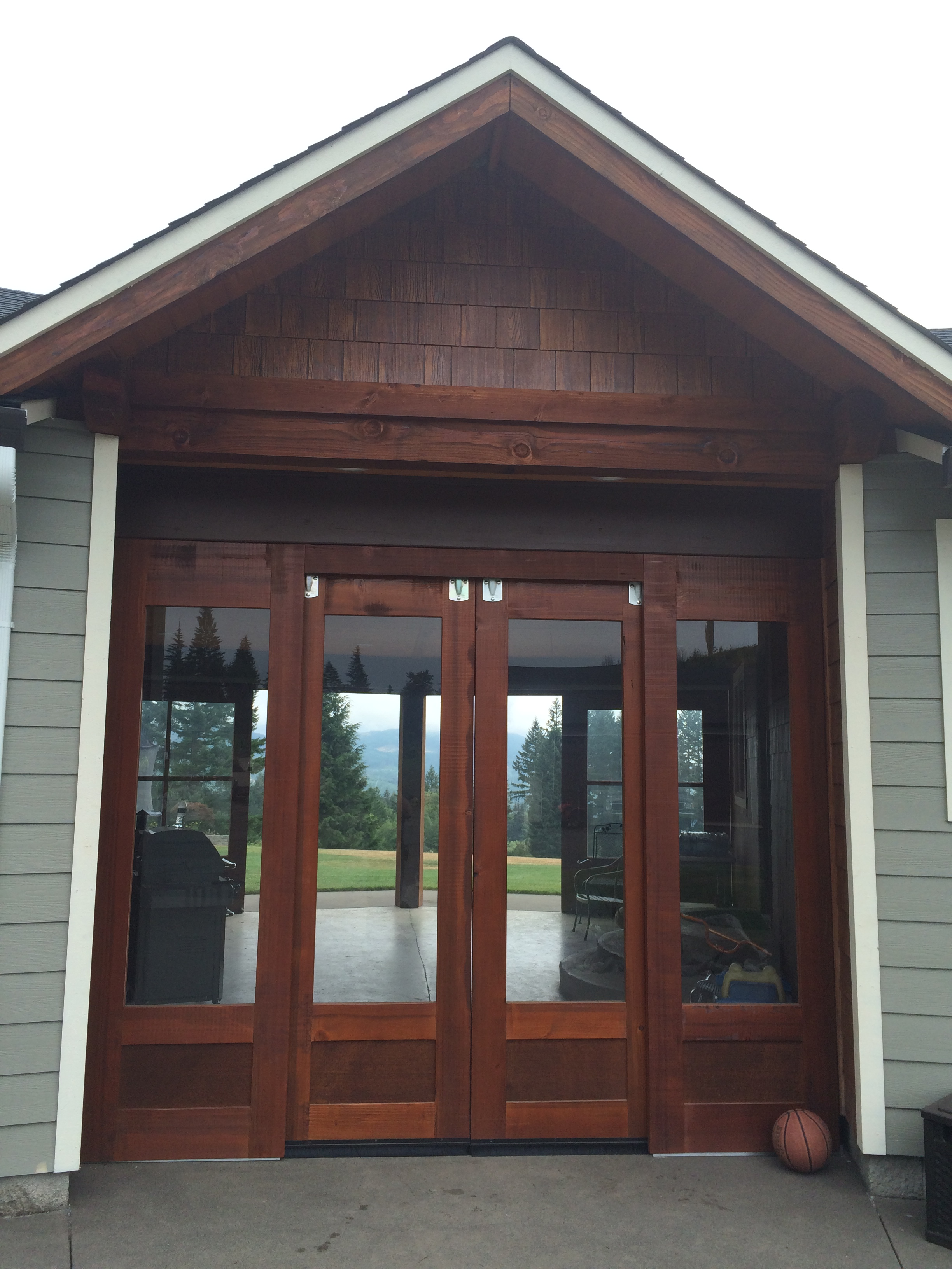 Exterior Glass Barn Doors exterior sliding barn door 5 panel design. wood trim windows